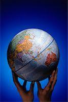 Hands Holding Globe Pacific Rim    Stock Photo - Premium Rights-Managednull, Code: 700-00008694