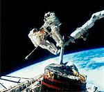 Astronauts on Canada Arm Deploying Communications Satellite    Stock Photo - Premium Rights-Managed, Artist: NASA                  , Code: 700-00010473