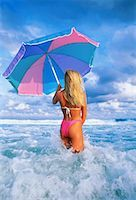 Back View of Woman in Swimwear Standing in Water Holding Umbrella    Stock Photo - Premium Rights-Managed, Artist: Rommel, Code: 700-00012108