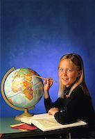 Student with Globe and Atlas    Stock Photo - Premium Rights-Managednull, Code: 700-00012749