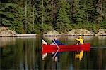 Woman and Man Canoeing with a Dog Tom Thomson Lake, Algonquin Park Ontario, Canada    Stock Photo - Premium Rights-Managed, Artist: Greg Stott, Code: 700-00012916