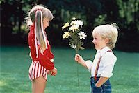 Boy Giving Girl Flowers    Stock Photo - Premium Rights-Managednull, Code: 700-00014900