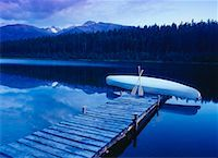 Dock and Canoe at Dusk Mayfield Lake, Northern Rockies British Columbia, Canada    Stock Photo - Premium Rights-Managednull, Code: 700-00016614