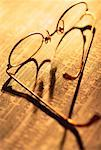 Eyeglasses on Financial Pages    Stock Photo - Premium Rights-Managed, Artist: Pierre Arsenault, Code: 700-00017121