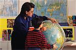Female Teacher and Student in Classroom Looking at Globe    Stock Photo - Premium Rights-Managed, Artist: Jim Craigmyle, Code: 700-00017346