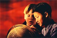 Two Boys Looking at Globe    Stock Photo - Premium Rights-Managednull, Code: 700-00017435