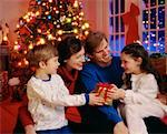 Family Exchanging Christmas Gifts    Stock Photo - Premium Rights-Managed, Artist: Greg Stott, Code: 700-00018432