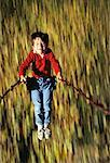 Overhead View of Boy on Swing In Autumn    Stock Photo - Premium Rights-Managed, Artist: Roy Ooms, Code: 700-00020411