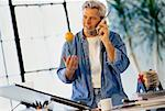 Man Using Cordless Phone at Drafting Table    Stock Photo - Premium Rights-Managed, Artist: MTPA Stock, Code: 700-00020823