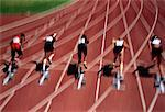 Back View of Runners Leaving Starting Blocks    Stock Photo - Premium Rights-Managed, Artist: Roy Ooms, Code: 700-00021716