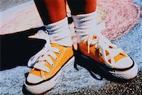 Close-Up of Child's Feet Wearing Sneakers    Stock Photo - Premium Rights-Managednull, Code: 700-00024225