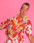 Portrait of Man Wearing Hawaiian Shirt and Leis    Stock Photo - Premium Rights-Managed, Artist: Graham French, Code: 700-00025516