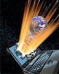 Globes Bursting Out of Laptop Computer Screen    Stock Photo - Premium Rights-Managed, Artist: Keith Ballinger, Code: 700-00025732