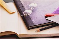 Eyeglasses, Pencil and Eraser on Ledgers    Stock Photo - Premium Rights-Managednull, Code: 700-00029142