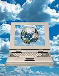 Laptop Computer and Globe Atlantic Ocean    Stock Photo - Premium Rights-Managed, Artist: Guy Grenier, Code: 700-00032055