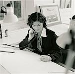Businesswoman Using Telephone    Stock Photo - Premium Rights-Managed, Artist: Michael Mahovlich, Code: 700-00033309