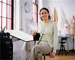 Portrait of Woman Sitting at Drafting Table    Stock Photo - Premium Rights-Managed, Artist: Masterfile, Code: 700-00034410