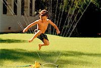 Boy Playing in Sprinkler    Stock Photo - Premium Rights-Managednull, Code: 700-00036620