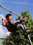 Boy on Swing    Stock Photo - Premium Rights-Managed, Artist: Rommel, Code: 700-00037920