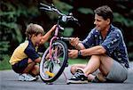 Father and Son Fixing Bicycle Outdoors    Stock Photo - Premium Rights-Managed, Artist: MTPA Stock, Code: 700-00038124