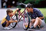 Father and Son Fixing Bicycle Outdoors    Stock Photo - Premium Rights-Managed, Artist: MTPA Stock, Code: 700-00038125