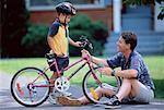 Father and Son Fixing Bicycle Outdoors    Stock Photo - Premium Rights-Managed, Artist: MTPA Stock, Code: 700-00038126