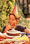 Boy Eating Cake Outdoors    Stock Photo - Premium Rights-Managed, Artist: Brian Pieters, Code: 700-00038298