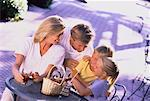 Family Eating Outdoors    Stock Photo - Premium Rights-Managed, Artist: Kevin Dodge, Code: 700-00038513