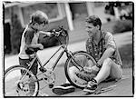 Father and Son Fixing Bicycle Outdoors    Stock Photo - Premium Rights-Managed, Artist: MTPA Stock, Code: 700-00039047