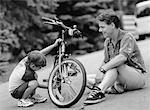 Father and Son Fixing Bicycle Outdoors    Stock Photo - Premium Rights-Managed, Artist: MTPA Stock, Code: 700-00039947