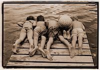 preteen girls bums - Back View of Children in Swimwear Looking over Edge of Dock    Stock Photo - Premium Rights-Managednull, Code: 700-00041153
