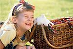 Girl with Puppy in Picnic Basket