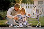 Father and Daughter Fixing Bicycle Outdoors    Stock Photo - Premium Rights-Managed, Artist: Kevin Dodge, Code: 700-00042376