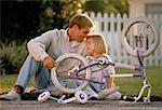 Father and Daughter Fixing Bicycle Outdoors    Stock Photo - Premium Rights-Managed, Artist: Kevin Dodge, Code: 700-00042377