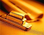 Gold Bars and Newspaper    Stock Photo - Premium Rights-Managed, Artist: David Muir, Code: 700-00042432
