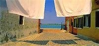 Laundry on Clothesline Island of Burano Venetian Lagoon, Italy    Stock Photo - Premium Rights-Managednull, Code: 700-00043475