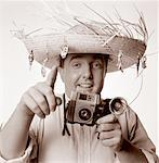 Portrait of Man in Straw Hat Holding Camera    Stock Photo - Premium Rights-Managed, Artist: Philip Rostron, Code: 700-00044390