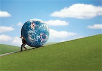 pushing - Businessman Rolling Globe Up Hill    Stock Photo - Premium Rights-Managednull, Code: 700-00044902