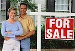 Portrait of Couple in Front of House with For Sale Sign    Stock Photo - Premium Rights-Managed, Artist: David Schmidt, Code: 700-00045602