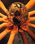 Circle of Hands Holding Wire Globe    Stock Photo - Premium Rights-Managed, Artist: Pierre Tremblay, Code: 700-00045894