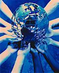 Ring of Hands Holding Wire Globe    Stock Photo - Premium Rights-Managed, Artist: Pierre Tremblay, Code: 700-00046256