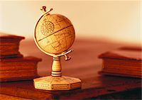 Globe on Stand on Desk with Books    Stock Photo - Premium Royalty-Freenull, Code: 600-00046594