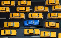 Overhead View of Yellow Taxis on Road with One Blue Taxi    Stock Photo - Premium Rights-Managednull, Code: 700-00046544