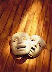 Comedy and Tragedy Masks on Wood Floor