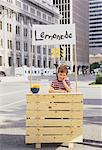 Boy with Lemonade Stand in Business District    Stock Photo - Premium Rights-Managed, Artist: Valerie Simmons, Code: 700-00047049
