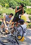 Group of Men Fixing Bicycle Outdoors    Stock Photo - Premium Rights-Managed, Artist: Masterfile, Code: 700-00047948