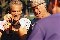 Group of Mature Men Playing Poker And Smoking Cigars Outdoors    Stock Photo - Premium Rights-Managednull, Code: 700-00047987