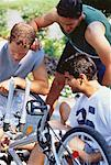 Men Repairing Bicycle Outdoors    Stock Photo - Premium Rights-Managed, Artist: Masterfile, Code: 700-00048137