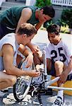 Men Repairing Bicycle Outdoors    Stock Photo - Premium Rights-Managed, Artist: Masterfile, Code: 700-00048272
