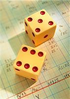 Close-Up of Dice on Ledger    Stock Photo - Premium Rights-Managednull, Code: 700-00049095